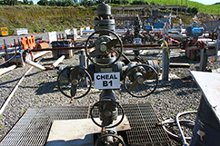 """A line of lonely wells, all with oil """"behind pipe"""" awaiting the expansion project completion"""